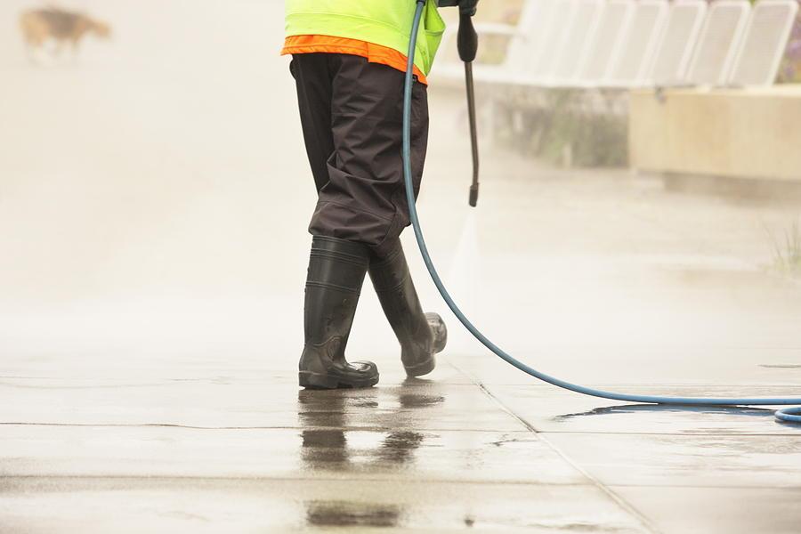 Worker Steam Cleans Sidewalk Dog Photograph by ChuckSchugPhotography