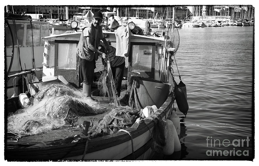 Fisherman Photograph - Working The Nets by John Rizzuto