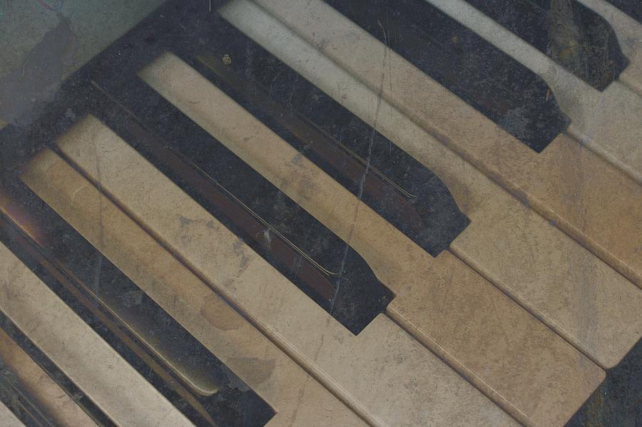 Piano Photograph - Worn Out Keys by Photographic Arts And Design Studio