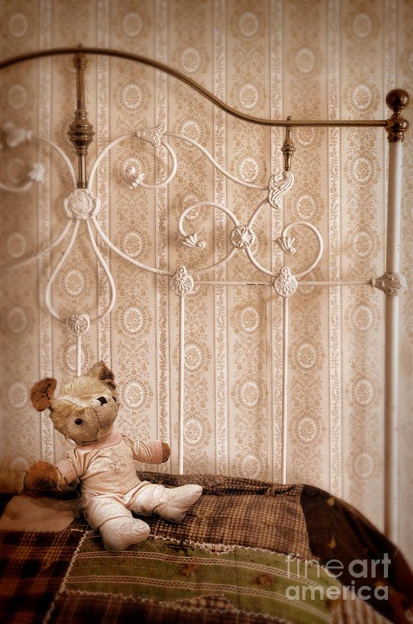 Bed Photograph - Worn Teddy Bear On Brass Bed by Jill Battaglia