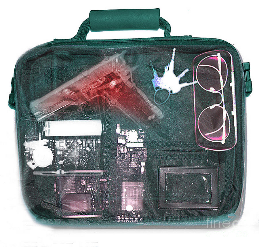 Terrorism Photograph - X-ray Of A Briefcase With A Gun by Scott Camazine