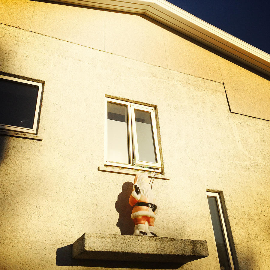 Quirky Photograph - Xmas decoration with Santa in June Akureyri Iceland by Matthias Hauser