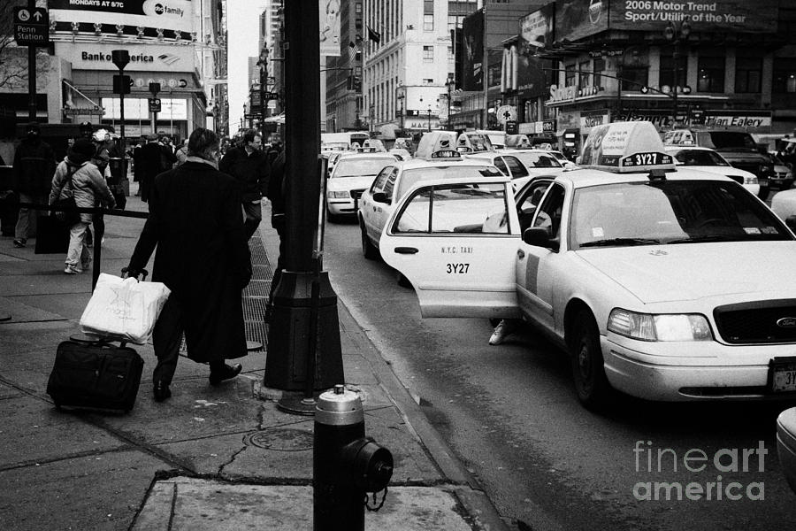 Usa Photograph - Yellow Cab On Taxi Rank Outside Madison Square Garden On 7th Avenue New York City Usa by Joe Fox