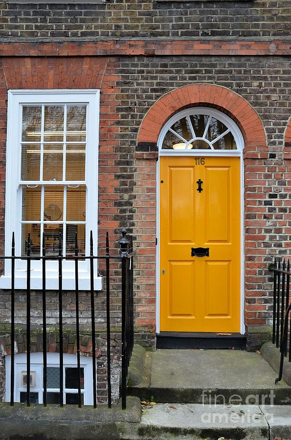 Yellow Door And Window In Brick House Photograph By Imran