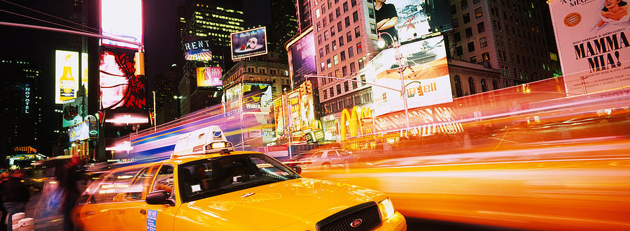 Color Image Photograph - Yellow Taxi On The Road, Times Square by Panoramic Images