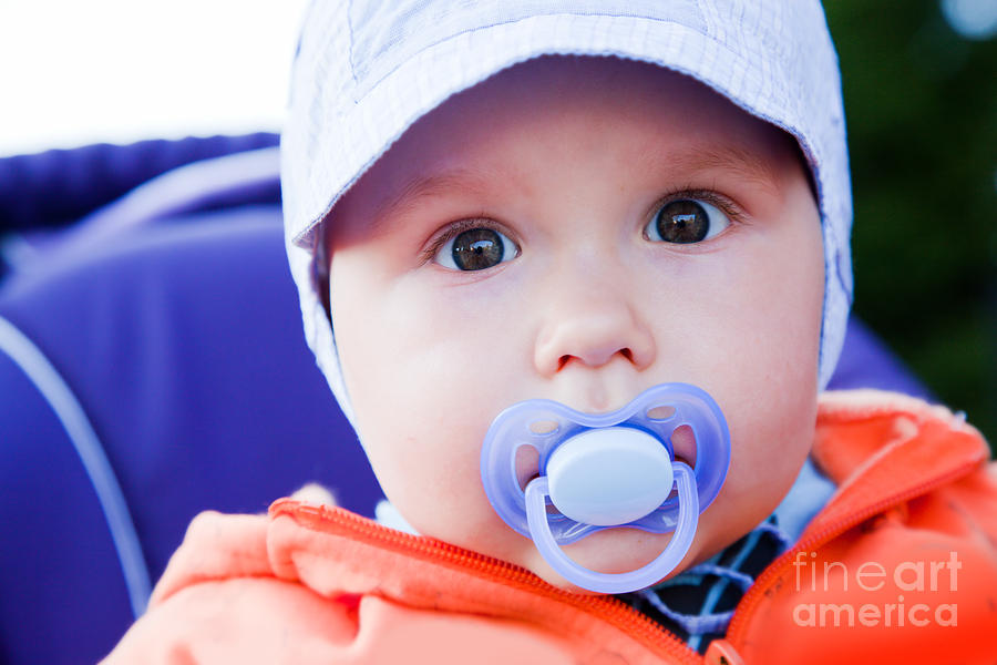 Child Photograph - Young Baby Boy With A Dummy In His Mouth Outdoors by Michal Bednarek