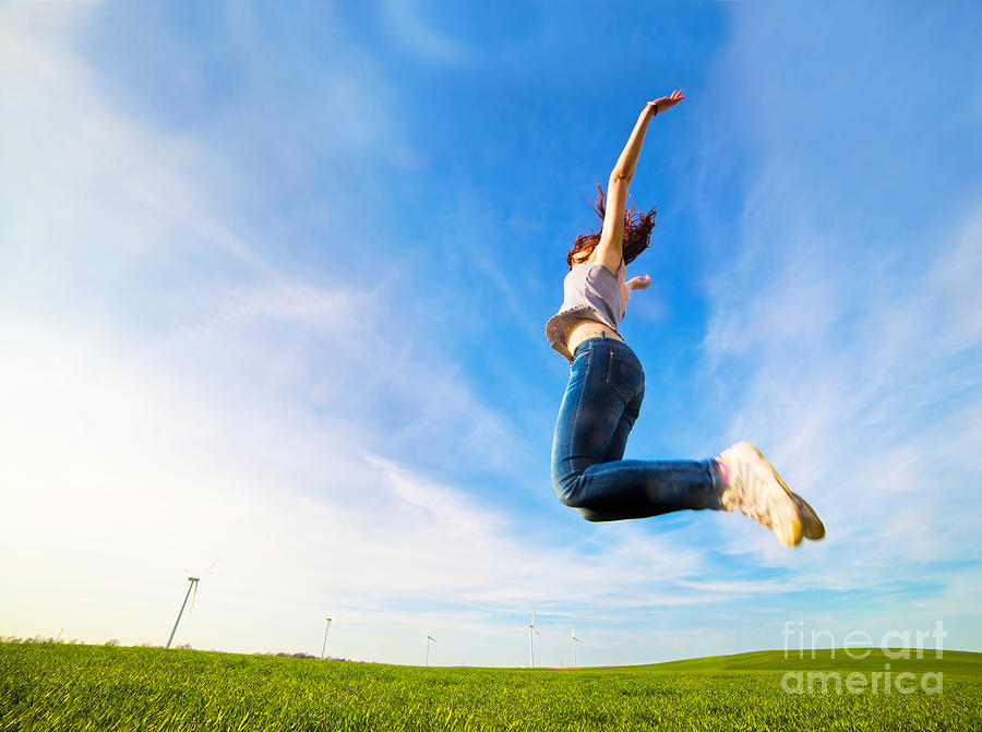Grass Photograph - Young Beautiful Woman Jumping For Joy by Michal Bednarek