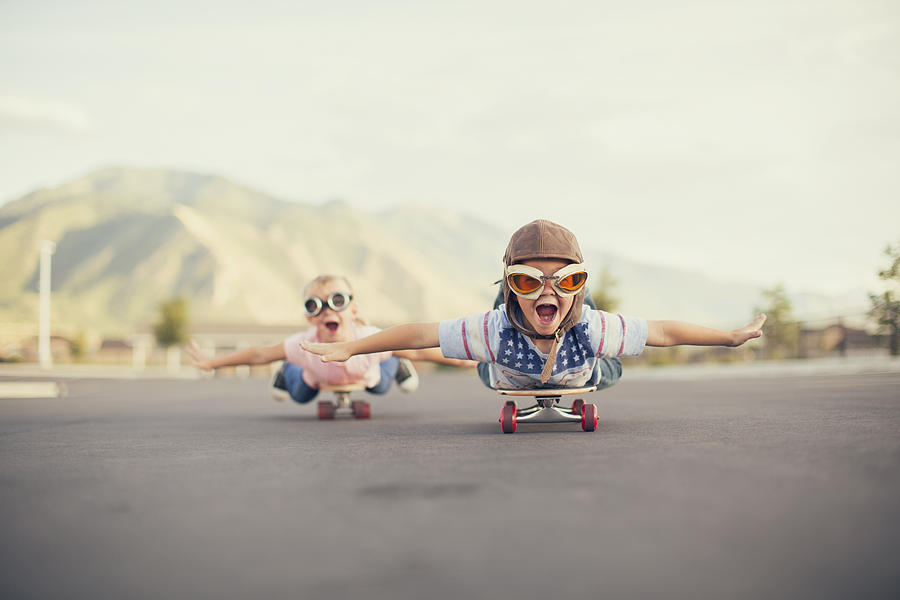 Young Boy and Girl Imagine Flying On Skateboard Photograph by RichVintage