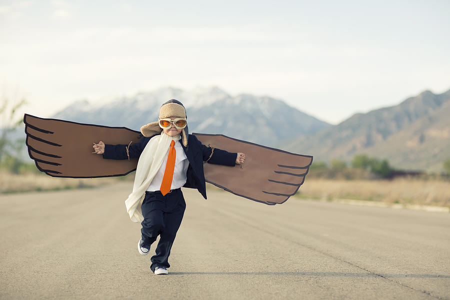 Young Boy Businessman Dressed In Suit With Cardboard Wings Photograph by Andrew Rich