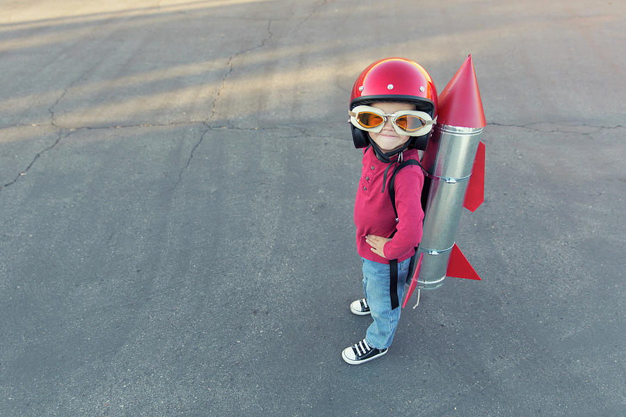 Young Boy Dressed In A Red Rocket Suit Photograph by Richvintage