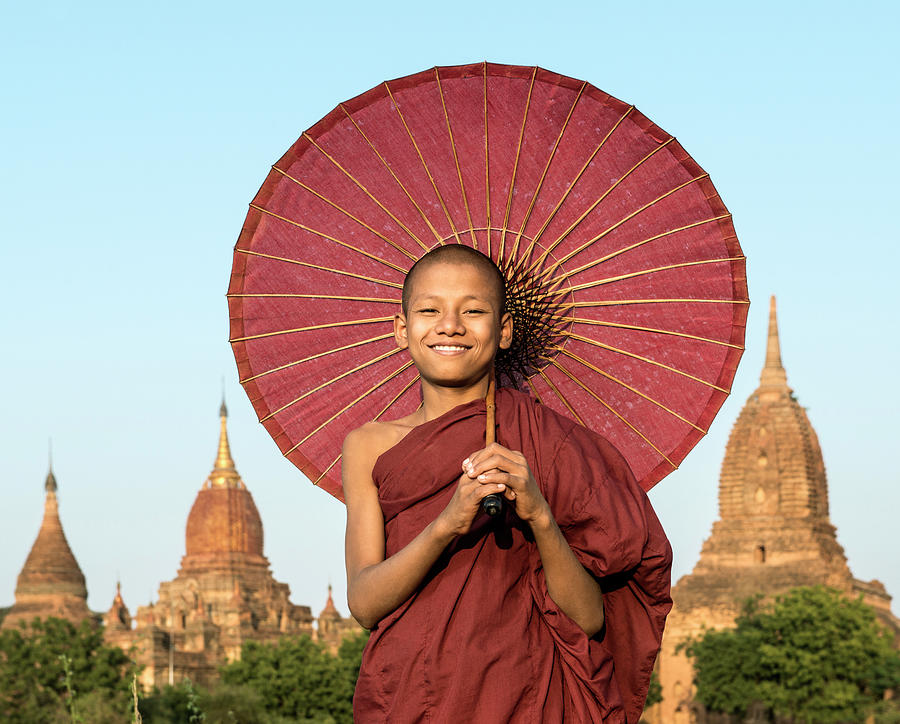 Young Buddhist Monk Holding Traditional Photograph by Martin Puddy