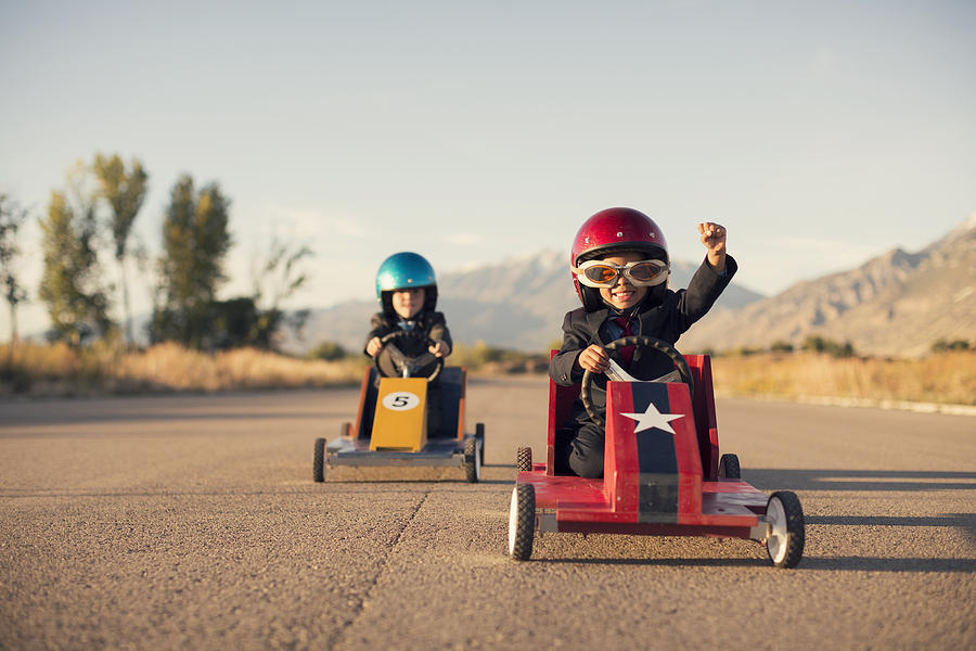 Young Business Boys in Suits Race Toy Cars Photograph by RichVintage