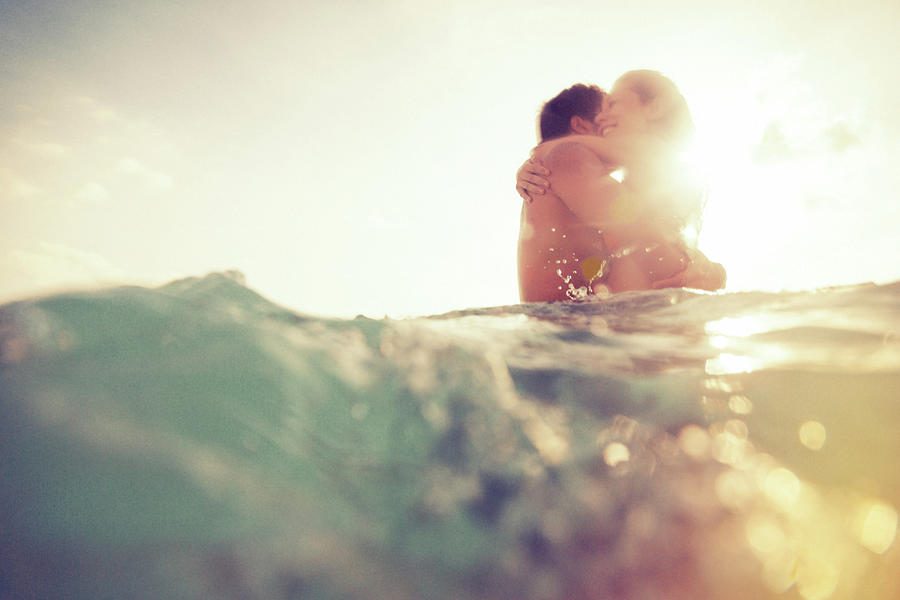 Young Couple Having Fun In The Sea Photograph by Nullplus