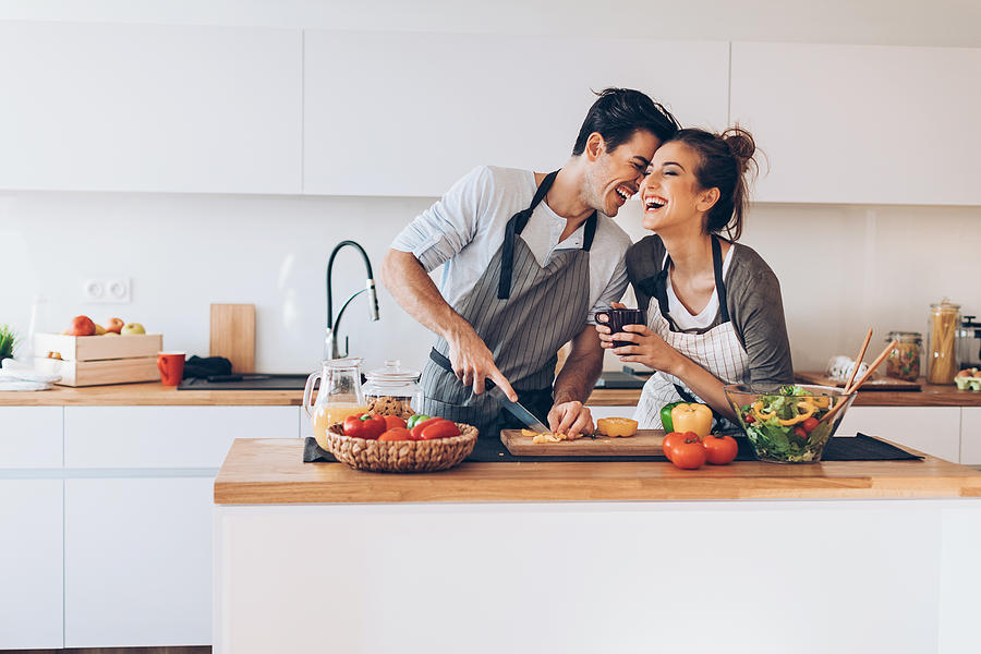 Young Couple In Love In The Kitchen Photograph by Pixelfit
