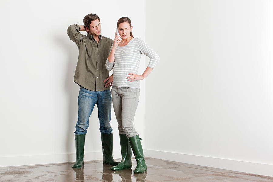 Young Couple On Flooded Floor Photograph by Image Source