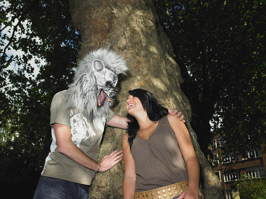 Young Couple Playing With Halloween Mask Photograph by Image Source