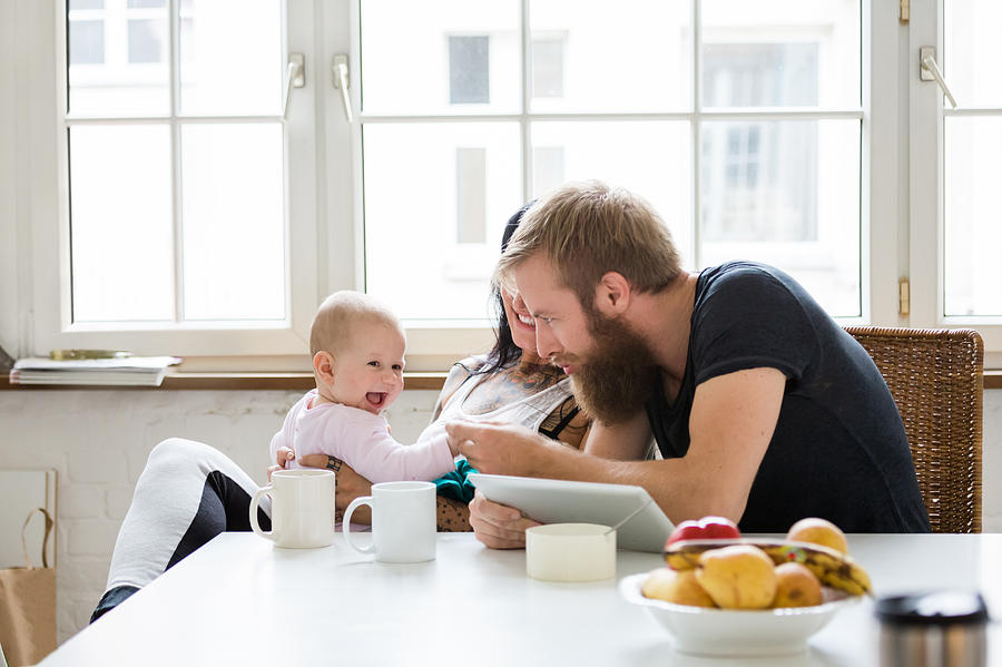 Young Family With Baby Having Fun Photograph by Hinterhaus Productions