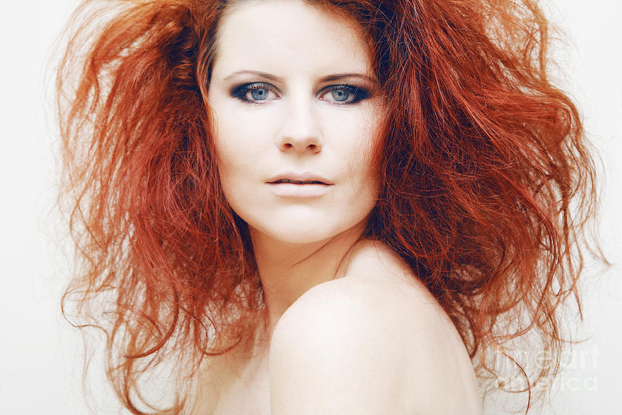 young fashion model with curly red hair photograph by