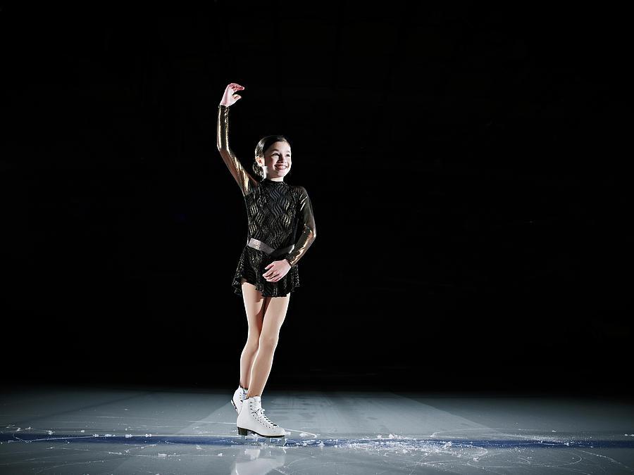 Young Female Figure Skater Finishing Photograph by Thomas Barwick