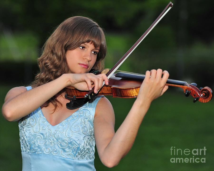 Young Girl Content to Play Her Violin in Nature by Wayne Nielsen