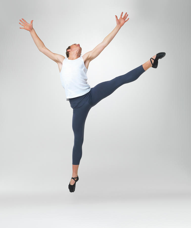 Young Man Ballet Dancing Against White Photograph by Yuri