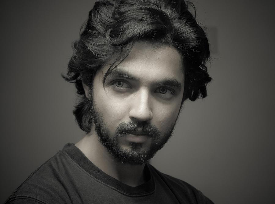 Young Man, Looking Away Photograph by Umair Wadood