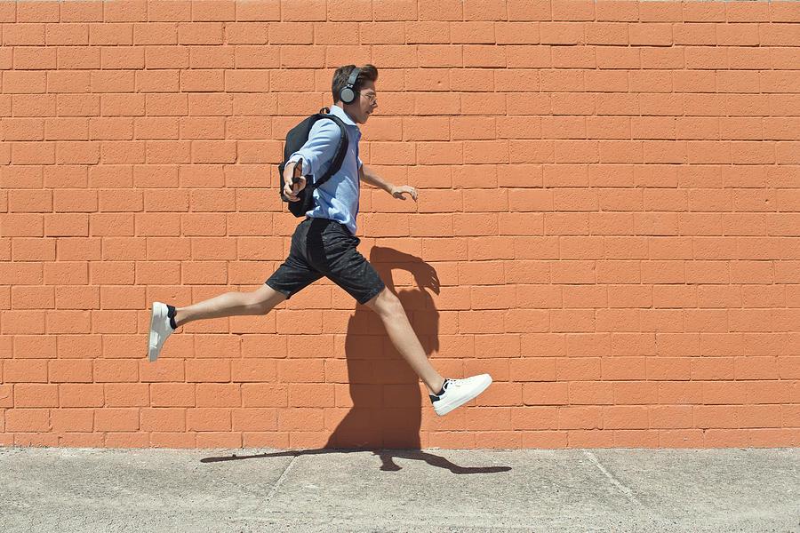 Young student runs to school Photograph by Francesco Carta fotografo