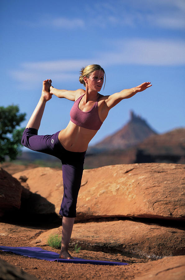 Young Woman Doing Yoga In Indian Creek Photograph By Justin Bailie