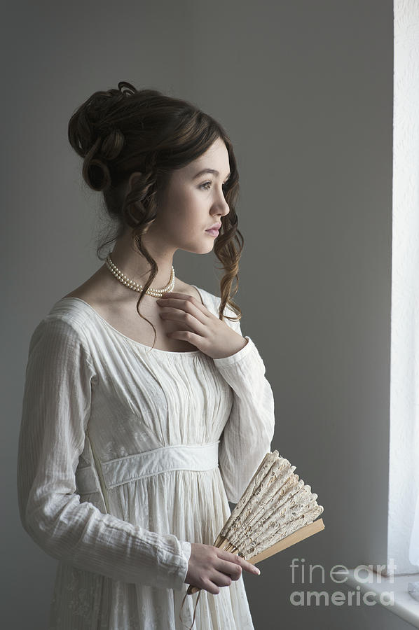Young Woman In A Regency Period Dress By The Window