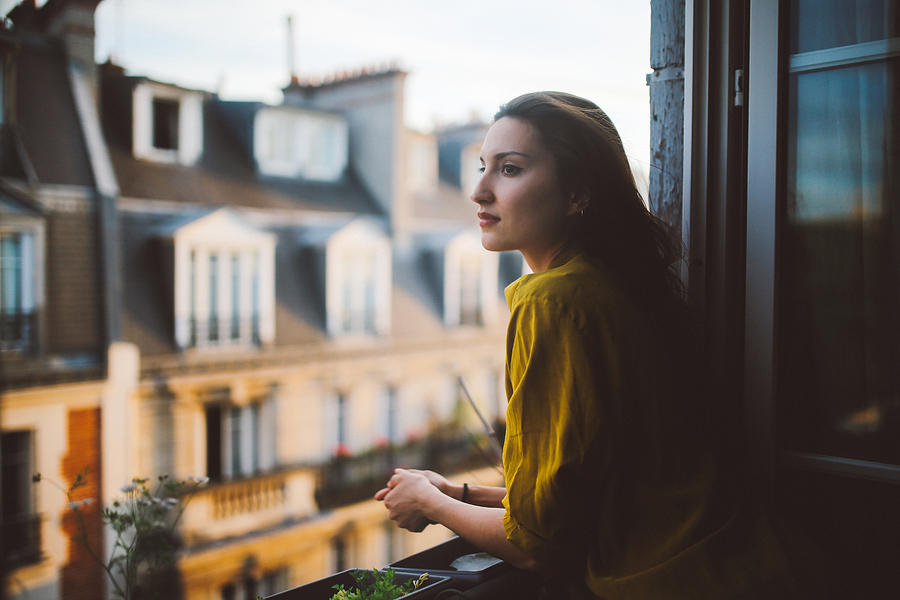 Young woman relaxing on the balcony of her Montmartre apartment Photograph by Lechatnoir