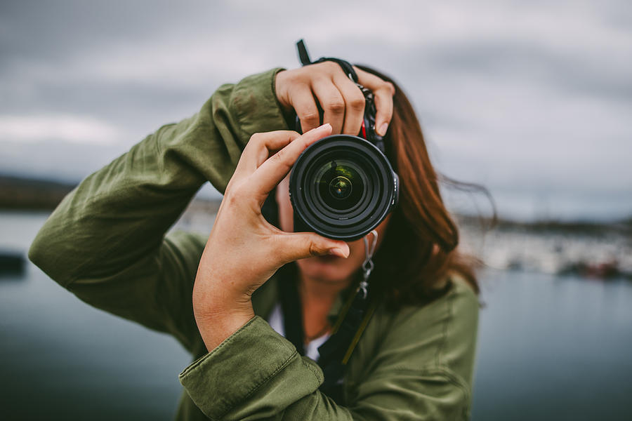 Young Woman Using Dslr Camera Photograph by MarioGuti
