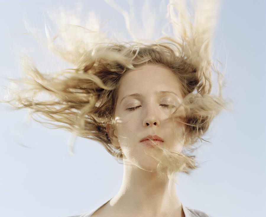 Young Woman With Hair Blowing In Face Eyes Closed Close Up By Matthias Clamer
