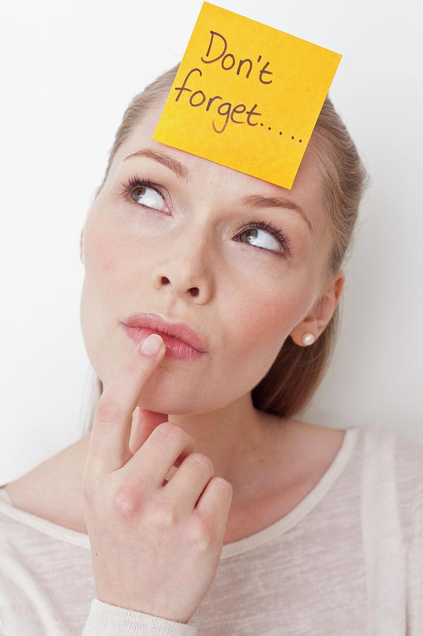 Female Photograph - Young Woman With Sticky Note by Ian Hooton/science Photo Library