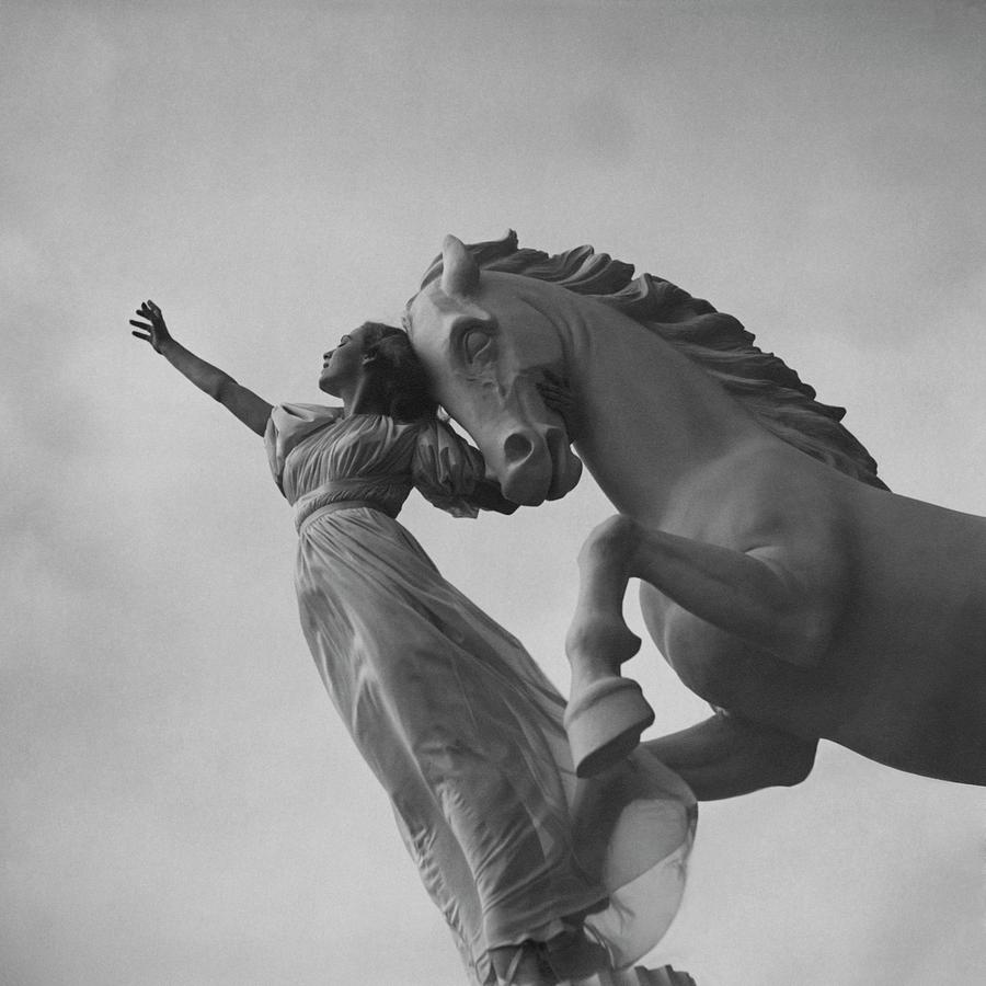 Zorina With A Horse Statue Photograph by Toni Frissell