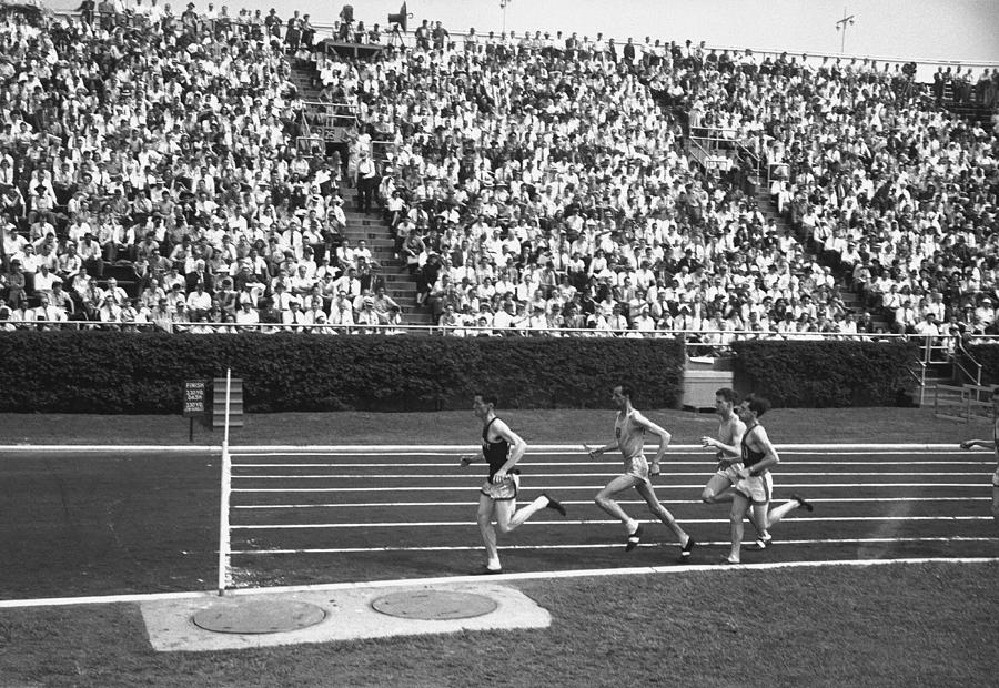 Adult Photograph - Track Athletes Running On Track, (b&w), Elevated View by George Marks