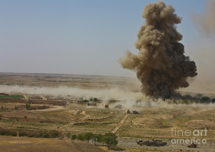 Improvised Explosive Device Photograph - A Cloud Of Dust And Debris Rises by Stocktrek Images