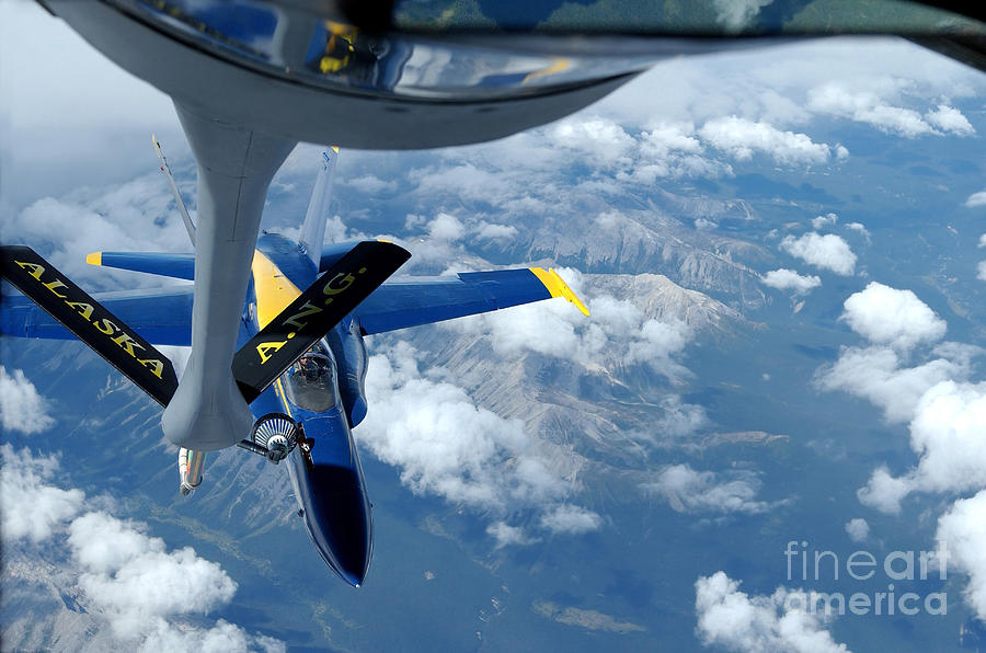 Horizontal Photograph - A Kc-135 Stratotanker Refuels An Fa-18 by Stocktrek Images