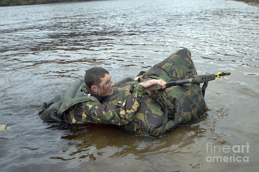 Supplies Photograph - A Soldier Participates In A River by Andrew Chittock