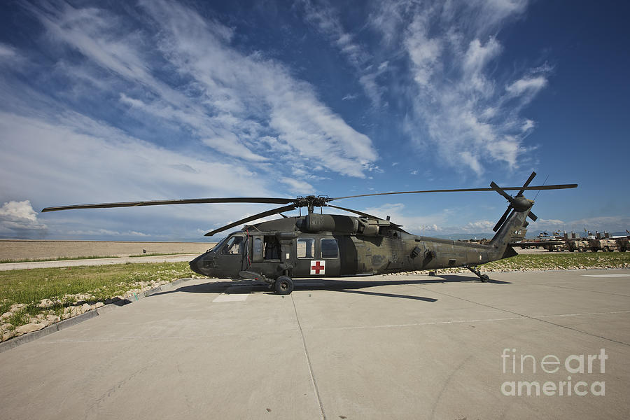 Blackhawk Photograph - A Uh-60l Blackhawk Parked On Its Pad by Terry Moore