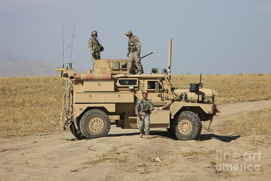 Vehicle Photograph - A U.s. Army Cougar Mrap Vehicle by Terry Moore