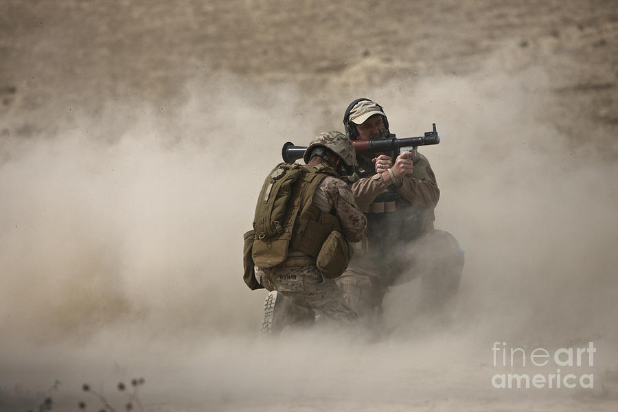 Afghanistan Photograph - A U.s. Contractor Fires by Terry Moore