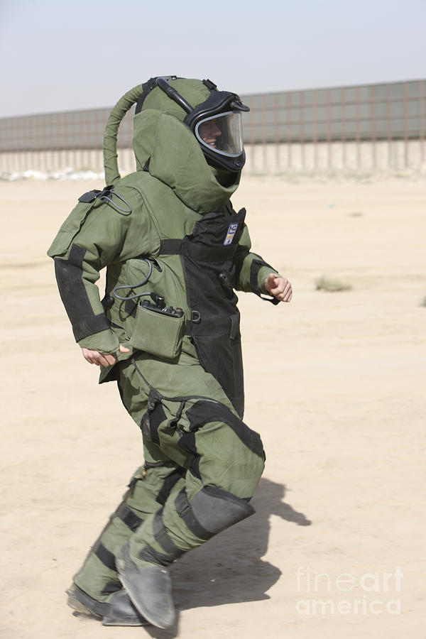 Explosive Ordnance Disposal Photograph - A U.s. Marine Tries Running In A Bomb by Terry Moore