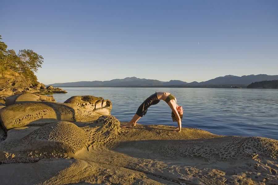 Hornby Island Photograph - A Woman Does Yoga At Sunset by Taylor S. Kennedy
