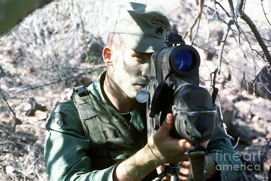 Military Photograph - An Army Ranger Sets Up An Anpaq-1 Laser by Stocktrek Images