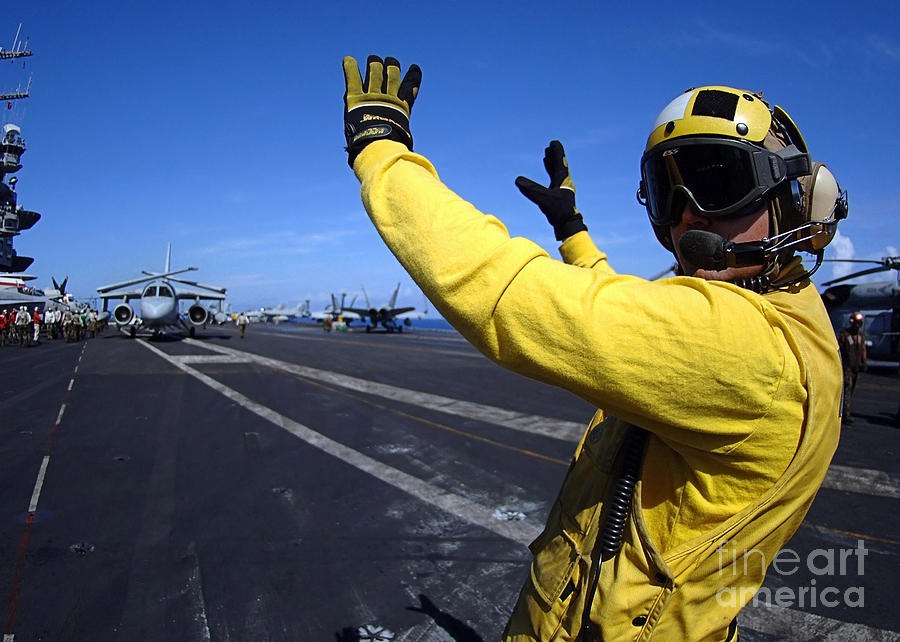 Horizontal Photograph - An Aviation Boatswains Mate Directs by Stocktrek Images