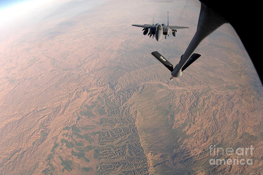Color Image Photograph - An F-15e Strike Eagle Is Refueled by Stocktrek Images