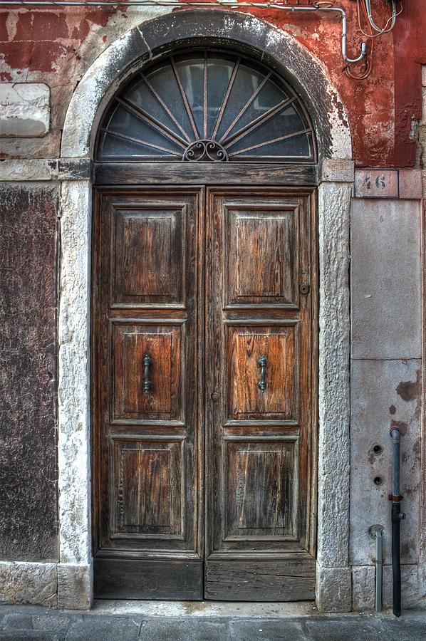 Door Photograph - an old wooden door in Italy by Joana Kruse