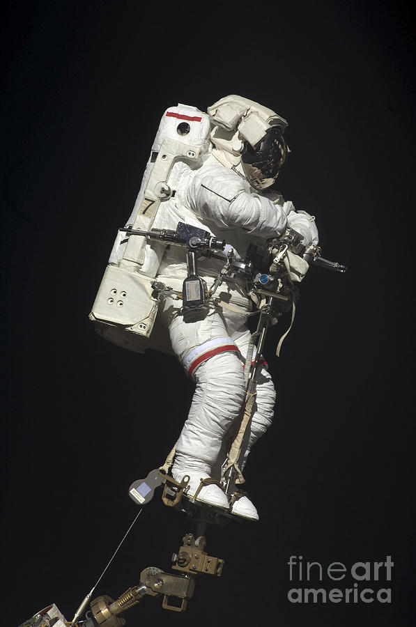 Astronaut Attached To A Foot Restraint Photograph by ...