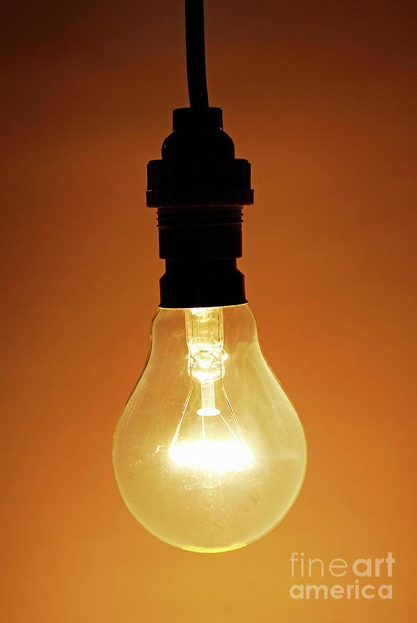 bare hanging light bulb photograph by sami sarkis