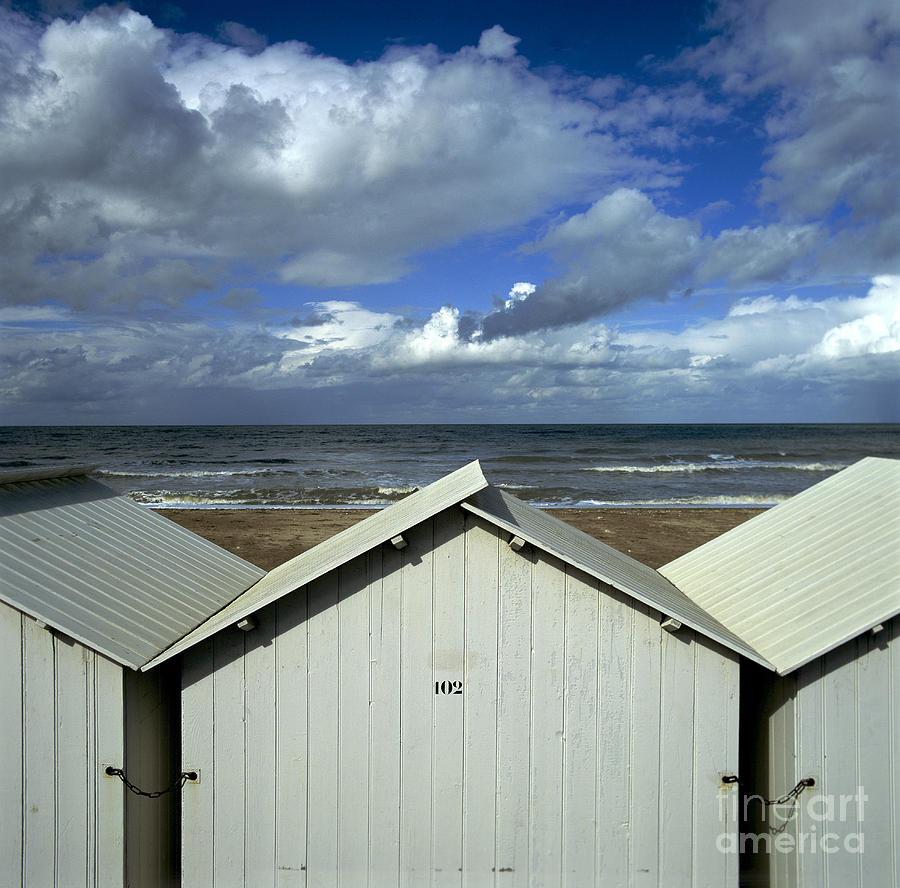 Wooden Photograph - Beach Huts Under A Stormy Sky In Normandy by Bernard Jaubert